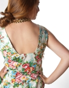 1960's inspired dress featuring an explosion of woven flowers. Back view
